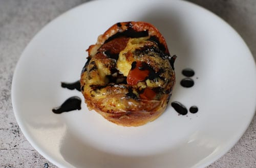 caprese egg cup with balsamic glaze
